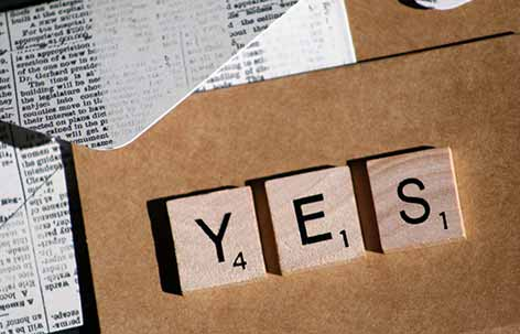 word yes made from wooden scrabble letters
