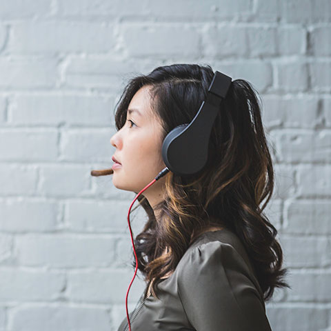 woman listening with headset